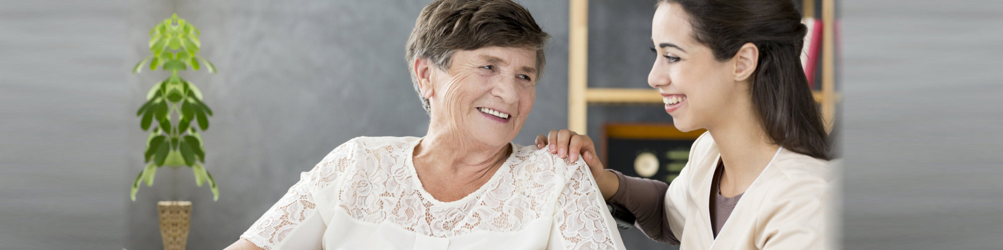 elder woman smiling with the caregiver