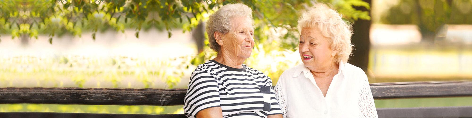 Senior women resting on bench in park